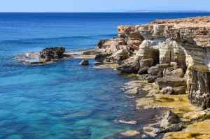 beach boulders cave cliff
