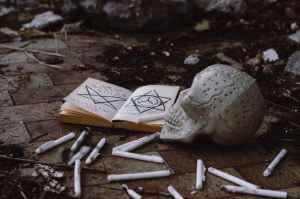 opened book near skull
